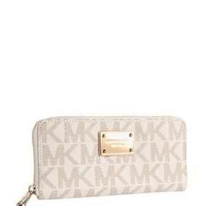 Like new! Michael kors zip up wallet gold accents